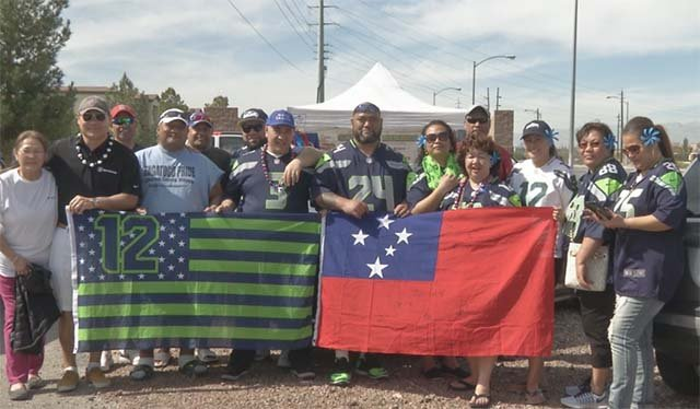 Rugby fans pose for a photo outside Sam Boyd Stadium in Las Vegas on March 4, 2016. (Source: FOX5)
