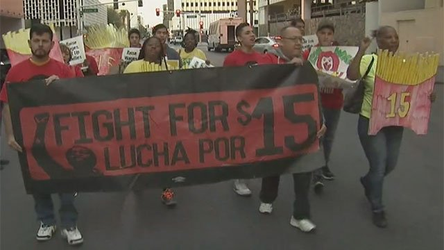 "Protesters with the ""Fight For $15"" campaign marched toward Fremont Street in downtown Las Vegas on April 14, 2016. (Armando Navarro/FOX5)"