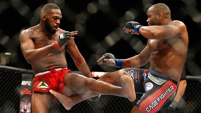 Daniel Cormier, right, kicks Jon Jones during their light heavyweight title mixed martial arts bout at UFC 182, Saturday, Jan. 3, 2015, in Las Vegas. (AP Photo/John Locher)