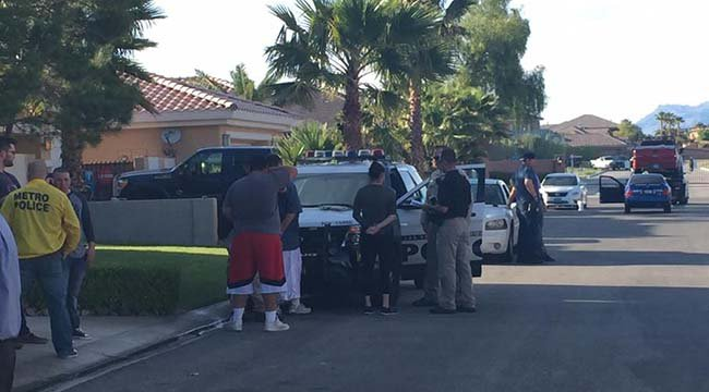 Metro police take squatters into custody near Ann Road and Hualapai Way on May 11, 2016. (Source: Elizabeth Watts/FOX5)