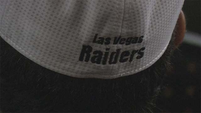 "A hopeful Oakland Raiders fan sports at ""Las Vegas Raiders"" hat at a committee meeting on June 23, 2016. (Source: FOX5)"