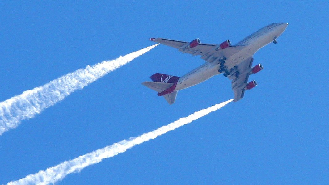 A plane burning fuel in the air.  (Source: Eric Record)
