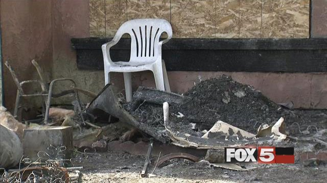 Charred remnants of a home rests in Sherrill Circle after a fire on Nov. 18, 2015. (FOX5)