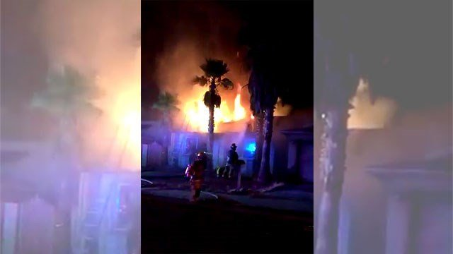 A FOX5 viewer captured flames shooting from a home on August 15, 2016. (Source: Francisco Martinez)