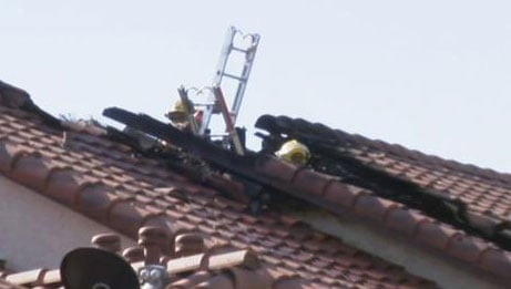 A ladder sticks out of a damaged roof after a fire near Valley View Boulevard and Twain Avenue on August 15, 2016. (FOX5)