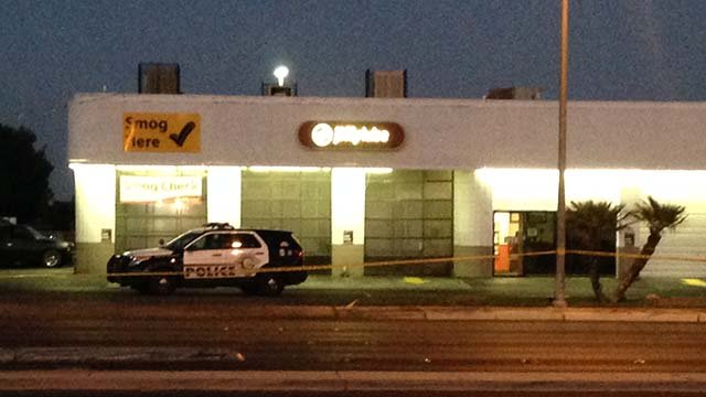 Crime tape and a Las Vegas Metro vehicle outside a Jiffy Lube located in the area of West Spring Mountain Road and South Rainbow Boulevard on Aug. 15, 2016. (Source: Roger Bryner/FOX5)