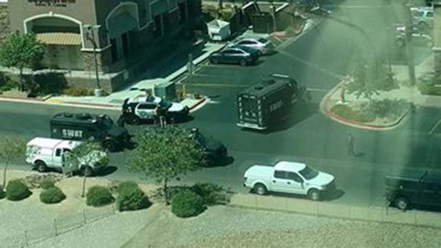 Metro police at the scene of a standoff with an armed person at a shopping complex in the northwest Valley on Aug. 16, 2016. (Source: Amy Nauenburg/Facebook)
