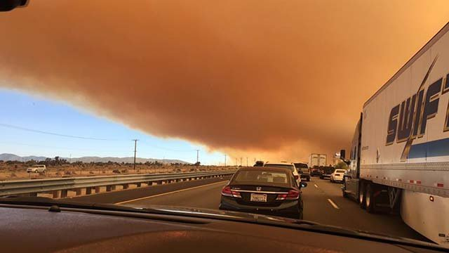 A thick cloud of smoke hovers over Interstate 15 in Southern California in this image from Aug. 16, 2016. (Source: Gabriella Tra)