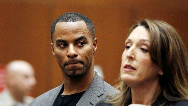 FILE - In this Feb. 20, 2014, file photo, former NFL All-Pro safety Darren Sharper looks toward his attorney, Blair Berk, during an appearance in Los Angeles Superior Court in Los Angeles. (AP Photo/Mario Anzuoni, Pool, File)