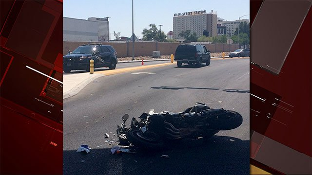 A wrecked motorcycle laid on it side after a crash near D Street and the I-15 northbound off-ramp on August 23, 2016. (Source: Nevada Highway Patrol)