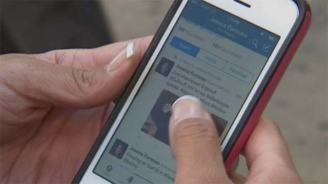 A student uses a cellphone in this file image. (Source: FOX5)