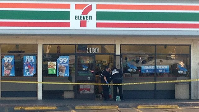 Investigators comb the scene of a shooting at 7-Eleven at Sahara and Lamb on June 5, 2016. (Eric Youngman/FOX5)