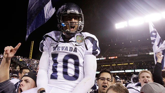 Nevada quarterback Colin Kaepernick (10) is hoisted by teammates and fans after beating Boston College during the Fight Hunger Bowl NCAA college football game in San Francisco, Sunday, Jan. 9, 2011. Nevada won 20-13. (AP Photo/Marcio Jose Sanchez)