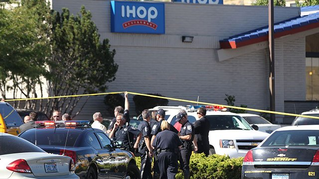Emergency personnel respond to a shooting at an IHOP restaurant in Carson City, Nev. on Tuesday, Sept. 6, 2011. Seven people were wounded after a gunman opened fire at the restaurant, authorities said. (AP Photo/Cathleen Allison)