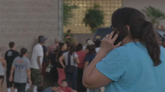 Parents wait outside Walter Johnson Junior High School amid a hazmat investigation on Wednesday, Sept. 7. (Source: FOX5)