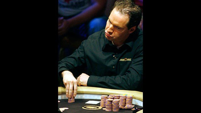 FILE - This March 6, 2006 file photo shows Ted Forrest mulls over a play during the National Heads-Up Poker championship finals at Caesars Palace in Las Vegas. (AP Photo/Isaac Brekken,File)
