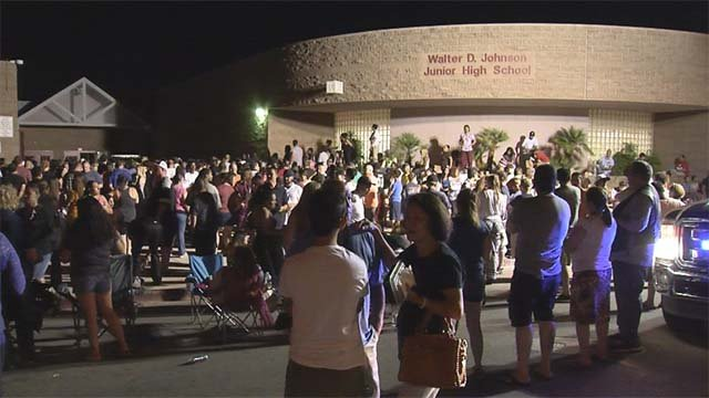 Parents wait outside Walter Johnson Junior High School in Las Vegas amid a hazmat investigation on Sept. 7, 2016. (Source: FOX5)