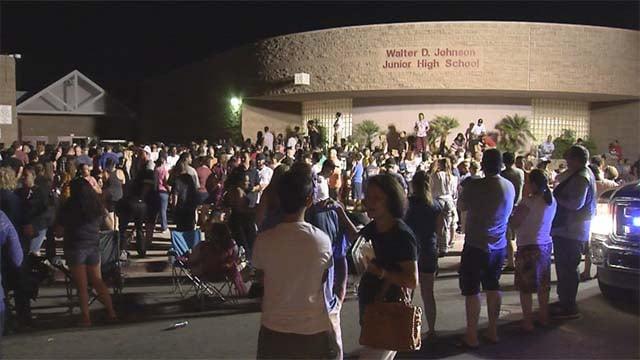 Parents wait outside Walter Johnson Junior High School in Las Vegas amid a hazmat investigation on Sept. 7, 2016. (Source: FOX5)