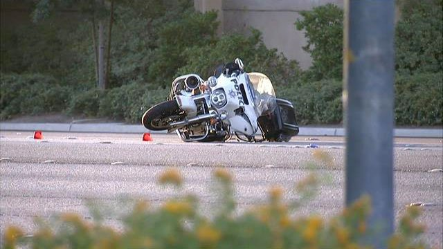 A Las Vegas Metro police motorcycle lays in the roadway on Tropicana Avenue near Durango Drive after a crash on Sept. 16, 2016. (Luis Marquez/FOX5)