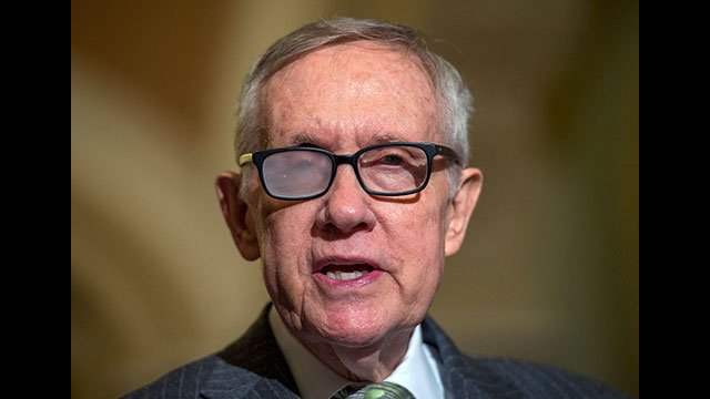 Senate Minority Leader Harry Reid of Nev. speaks to reporters on Capitol Hill in Washington, Tuesday, March 17, 2015, following a policy Luncheon. (AP Photo/Molly Riley)