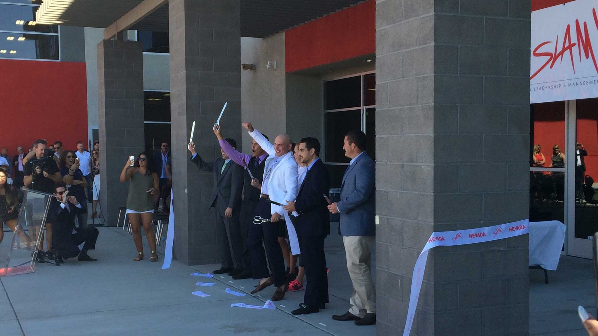 Rapper Pitbull cuts the ribbon to his Sports & Leadership Academy (SLAM) in Henderson.