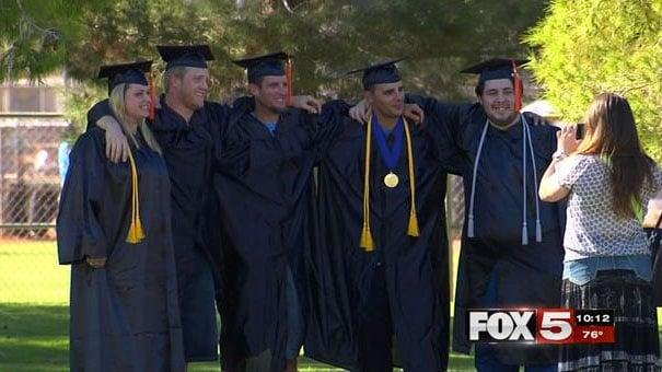 ITT Technical School graduates pose for a picture on Sept. 17, 2016. (Kurt Rempe/FOX5)