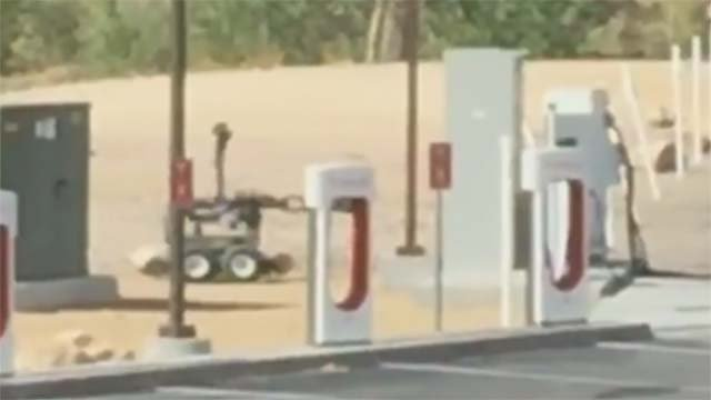 A police robot investigates a suspicious package in Beatty, NV, on Sept. 19, 2016. (Source: FOX5)