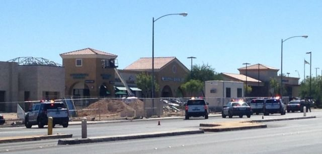 Police at the scene of a hostage situation near Rainbow Boulevard and Warm Springs Road on Sept. 25, 2016. (Roger Bryner/FOX5)