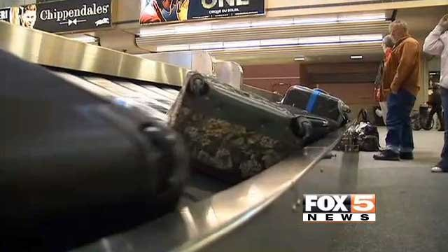 Passengers wait for their luggage at baggage claim at McCarran Airport. (File/FOX5)