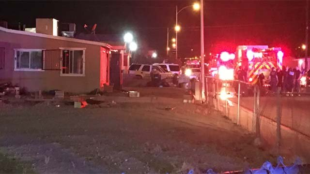 Firefighters at the scene of a house fire in the area of East Nelson Avenue and North Spear Street in North Las Vegas on Oct. 3, 2016. (Source: FOX5)