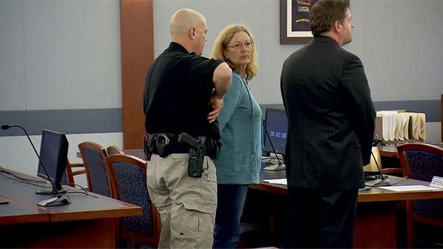 Mary Jo Frazier, center, is placed in handcuffs after her bail was set in Clark County District Court on March 8, 2016.