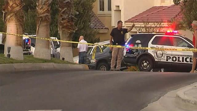 Las Vegas Metro police at the scene of a fatal shooting on Henniker Way on Oct. 4, 2016. (Source: FOX5)