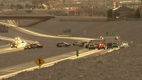 Law enforcement continued to block northbound lanes of the 215 Beltway at Hualapai Way following an officer-involved shooting on Oct. 13, 2016. (Armando Navarro/FOX5)