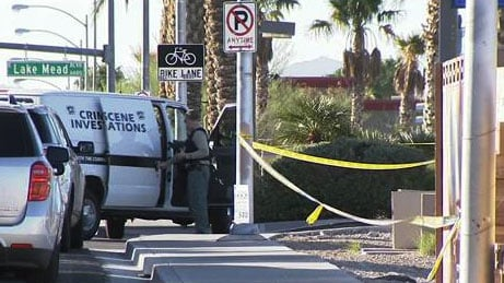 Las Vegas Metro police taped off the scene of a homicide near Lake Mead and Hollywood boulevards on Oct. 13, 2016. (Eric Youngman/FOX5)