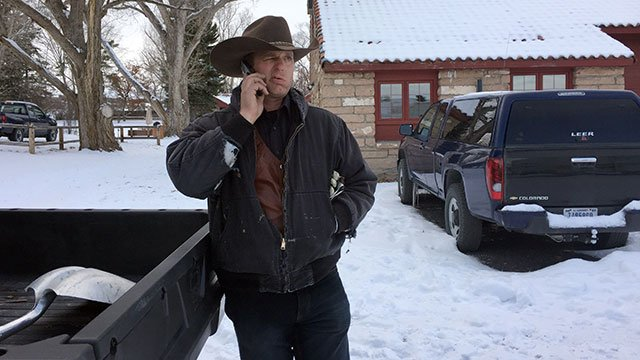 Ryan Bundy talks on the phone at the Malheur National Wildlife Refuge near Burns, Ore., Jan. 3, 2016. Bundy is one of the protesters occupying the refuge to object to a prison sentence for local ranchers for burning federal land. (AP Photo/Rebecca Boone)