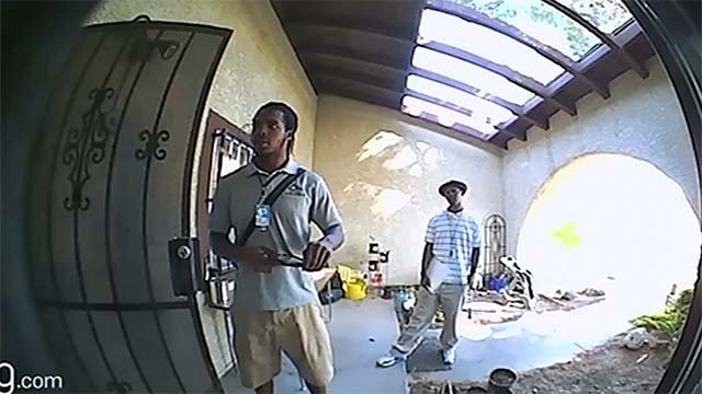 Two men who identified themselves as employees of Nevada Home Water Services on surveillance video. (Source: Debra Almache)