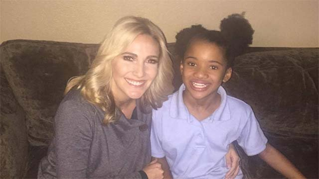 FOX5 reporter Cyndi Lundeberg appears with 9-year-old Brazyl Ward in this image from Oct. 28, 2016. (Source: Cyndi Lundeberg/FOX5)