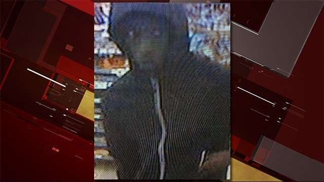 Police said the armed robber wore a black hooded sweatshirt before using a handgun to commit the robberies. (Source: LVMPD)