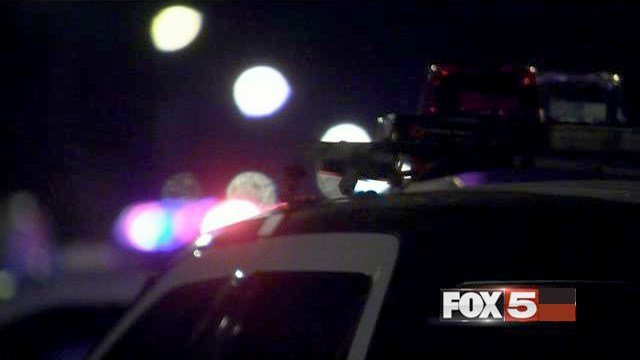 A police vehicle is shown in the area of Twain Avenue and Nellis Boulevard on Nov. 22, 2016. (FOX5)