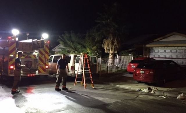 Firefighters at the scene of an overnight house fire in east Las Vegas on Nov. 23, 2016. (Luis Marquez/FOX5)
