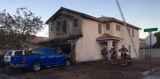 Firefighters at the scene of an early morning house fire in south Las Vegas on Nov. 26, 2016. (Greg Cassell/CCFD)
