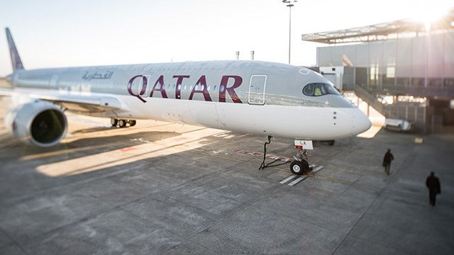 The first Airbus A350 for Qatar Airways sits on the tarmac during the hand over ceremony in Toulouse, southwestern France, Monday, Dec.22, 2014. (AP Photo/Fred Lancelot)