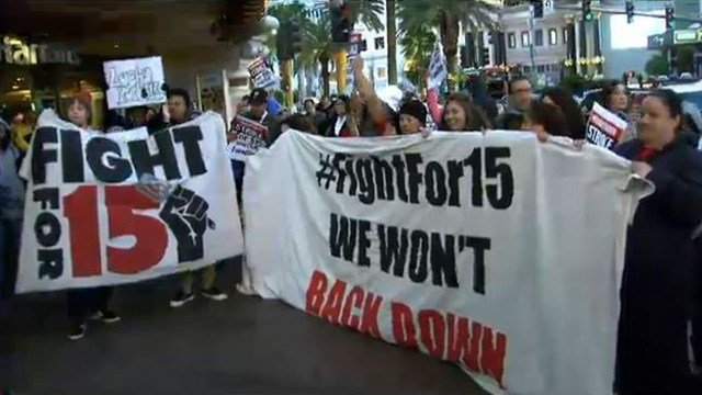 Demonstrators rallied outside of a McDonald's located on the Las Vegas Strip as part of the 'Fight for $15' protest on Nov. 29, 2016. (Isaac Torres/FOX5)