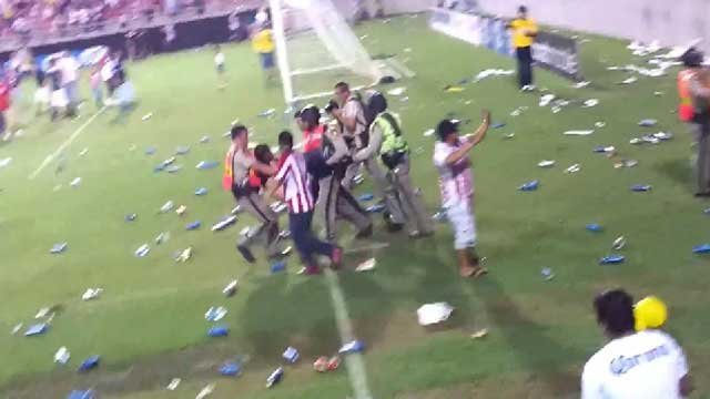 YouTube user DJKORA uploaded video clips appearing to depict fans on the field at Sam Boyd Stadium during the Club America-Chivas match on July 3, 2013. The video showed fans throwing bottles at each other and police in riot gear. (DJKORA/YouTube.com)
