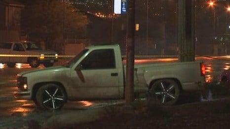 A pickup truck rests on a sidewalk along Owens Avenue near Walnut Road after a crash on Jan. 12, 2017. (FOX5)