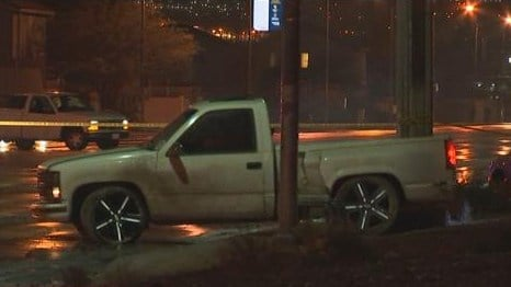 A pickup truck rests on a sidewalk along Owens Avenue near Walnut Road after a crash on Jan. 12, 2017. (FOX5)