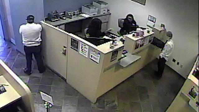 Police said another man pointed a handgun at workers during the robbery on Jan. 24, 2017. (Source: Henderson PD)