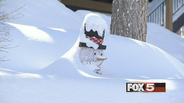 A front yard winter decoration is shown covered heavy snow at Mt. Charleston. (FOX5)