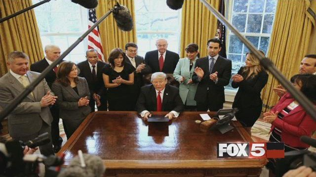 Irma Aguirre, who is just right of President Donald Trump, was one of nine small business owners who appeared with the president during an executive order signing.