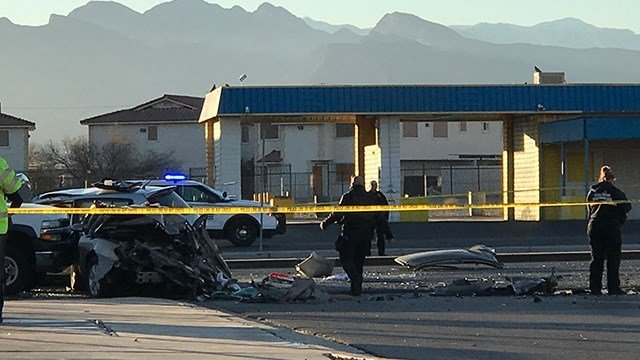 Police sift through the wreckage left by a crash that involved a North Las Vegas police detective on Jan. 6, 2017. (Gai Phanalasy/FOX5)